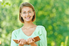 Young woman glasses read book Royalty Free Stock Photography