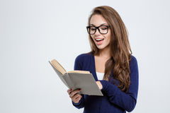 Young woman in glasses reading book Stock Images