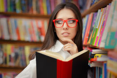 Young Woman with Glasses Reading Royalty Free Stock Photo