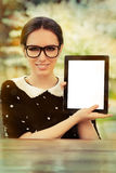 Young Woman with Glasses Showing an Empty Tablet Screen Stock Image