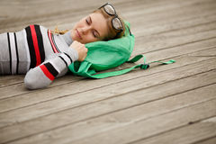 Young woman with glasses is sleeping outdoors Royalty Free Stock Photography