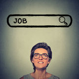 Young woman in glasses smiling looking for a new job Royalty Free Stock Image