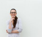 Young woman with glasses smiling Royalty Free Stock Images