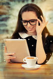 Young Woman with Glasses and Tablet Having Coffee Stock Photos