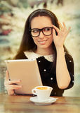 Young Woman with Glasses and Tablet Having Coffee Royalty Free Stock Photography