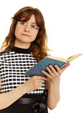 Young woman in glasses with  textbook Royalty Free Stock Photography