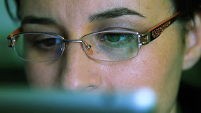 Young woman with glasses working on a tablet computer stock video footage