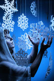 Young woman in glistering make up holding paper snowflake Royalty Free Stock Photos