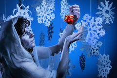 Young woman in glistering make up holding red Christmas decoration ball Royalty Free Stock Photos