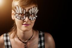 Young woman in glitter mask Stock Image