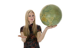 Young woman with  globe Royalty Free Stock Photography