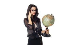 Young woman with globe on isolated background. Businesswoman dressed in black with laptop isolated  on a white background Royalty Free Stock Images