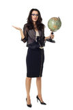 Young woman with globe on isolated background. Businesswoman dressed in black with laptop isolated on a white background Stock Photos