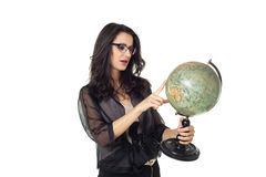 Young woman with globe on isolated background. Young woman with an old globe isolated on white background Stock Photo