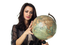 Young woman with globe on isolated background. Young woman with an old globe isolated on white background Royalty Free Stock Photography