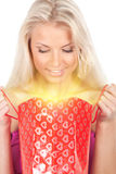 Young woman with glowing gift bag Stock Photography