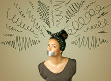 Young woman with glued mouth and curly lines Royalty Free Stock Photos