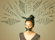 Young woman with glued mouth and curly lines Stock Photo