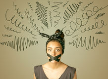 Young woman with glued mouth and curly lines Stock Images