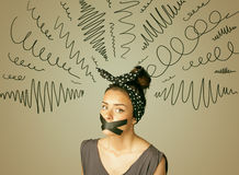 Young woman with glued mouth and curly lines Royalty Free Stock Images