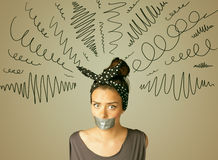 Young woman with glued mouth and curly lines Royalty Free Stock Image