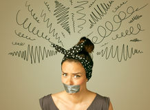 Young woman with glued mouth and curly lines Royalty Free Stock Photo