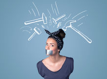 Young woman with glued mouth and hammer marks Royalty Free Stock Images