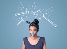 Young woman with glued mouth and hammer marks Stock Images