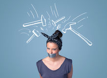 Young woman with glued mouth and hammer marks Royalty Free Stock Photography