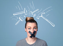 Young woman with glued mouth and hammer marks Stock Photo