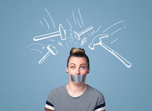 Young woman with glued mouth and hammer marks Stock Image
