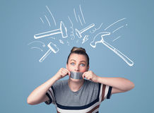 Young woman with glued mouth and hammer marks Royalty Free Stock Photos