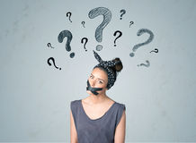 Young woman with glued mouth and question mark symbols Royalty Free Stock Images