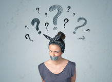Young woman with glued mouth and question mark symbols Stock Image