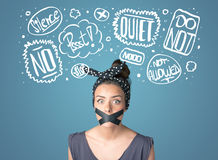 Young woman with glued mouth and thought clouds Royalty Free Stock Photos