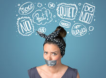 Young woman with glued mouth and thought clouds Stock Photography