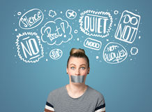 Young woman with glued mouth and thought clouds Royalty Free Stock Photography