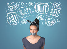 Young woman with glued mouth and thought clouds Royalty Free Stock Images