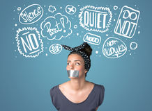 Young woman with glued mouth and thought clouds Royalty Free Stock Photo