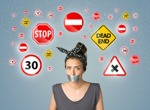 Young woman with glued mouth and traffic signals Royalty Free Stock Images