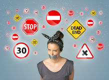Young woman with glued mouth and traffic signals Stock Image