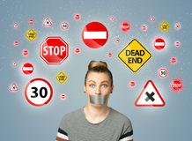 Young woman with glued mouth and traffic signals Royalty Free Stock Photography