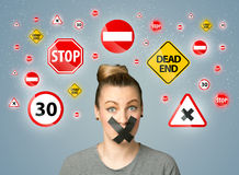 Young woman with glued mouth and traffic signals Royalty Free Stock Photo