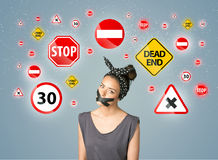 Young woman with glued mouth and traffic signals. Young woman with taped mouth and traffic signals around her head Royalty Free Stock Image