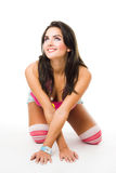 Young woman go down on all fours smile in pink clo Royalty Free Stock Image