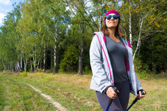 Young woman goes Nordic walking Stock Image