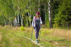 Young woman goes Nordic walking Stock Photo