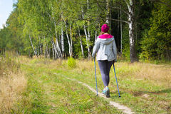 Young woman goes Nordic walking Royalty Free Stock Photography