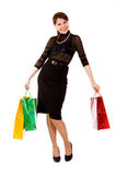 Young woman goes shopping Royalty Free Stock Photography