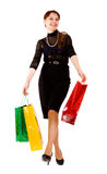 Young woman goes shopping Stock Photos